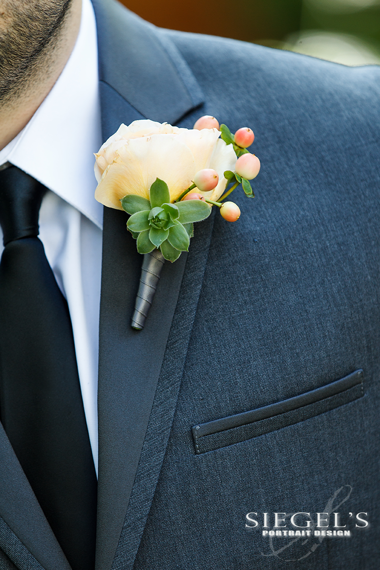 Groom Michaelu0027s Boutonniere Featured A Garden Rose With Hypericum Berries  And A Mini Succulent.