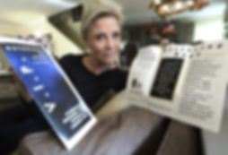 Veterans in Pain founder Micaela Bensko displays the organization's material at her Valencia home. Dan Watson/The Signal