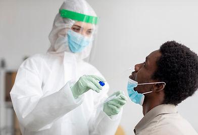 doctor-taking-coronavirus-test-sample.jp