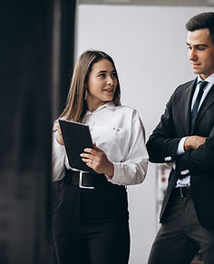 male-female-business-people-working-tabl