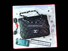 Classic Black Chanel Handbag Cake with accessories bbkakes.jpg