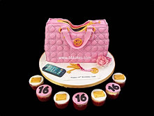 Pink Qulited Michael Kors Bag Cake with accessories and cupcakes bbkakes