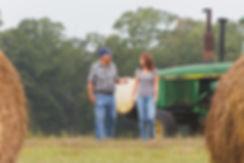 Dad and I walking in hay field2.jpeg