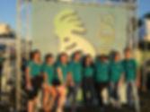 SOJ volunteer group at front gate scrim