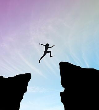 man-jump-through-gap-hill-man-jumping-cl