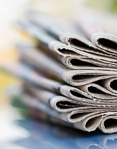 time-read-concept-newspapers-folded-stacked.jpg