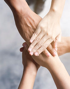 business-people-put-hands-together_34011