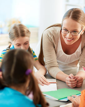 happy-teacher-listening-her-students.jpg