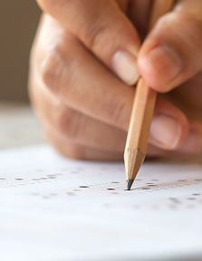 exam-test-school-university-concept-hand-student-holding-pencil-writing-standardized-answe