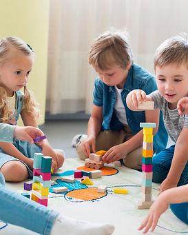 kids-playing-together-kindergarten.jpg