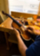 Antique violin repair