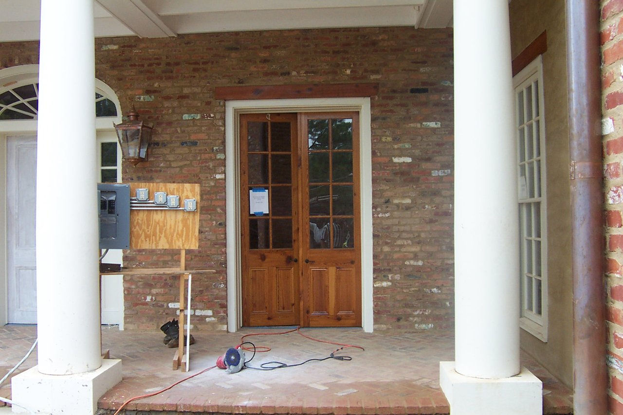 heart pine front doors are installed on a new home