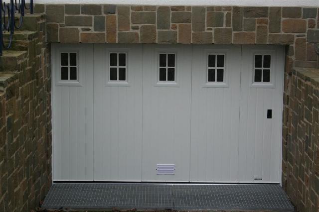 Fab portes automatiques portes sectionnelles rideaux m talliques charente - La toulousaine porte sectionnelle ...