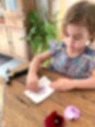 Child-peeling-off-flower-from-flower-fla