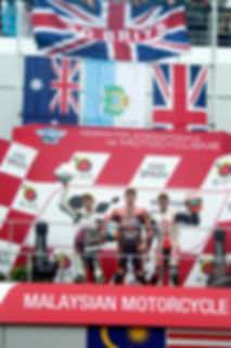 Gino Rea on the podium at Sepang