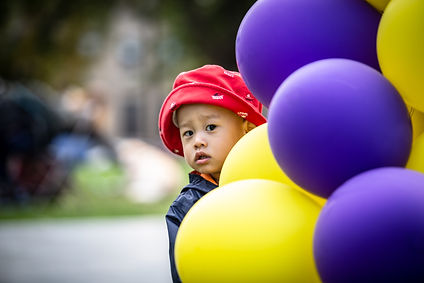Young boy with balloons at Sophie Park