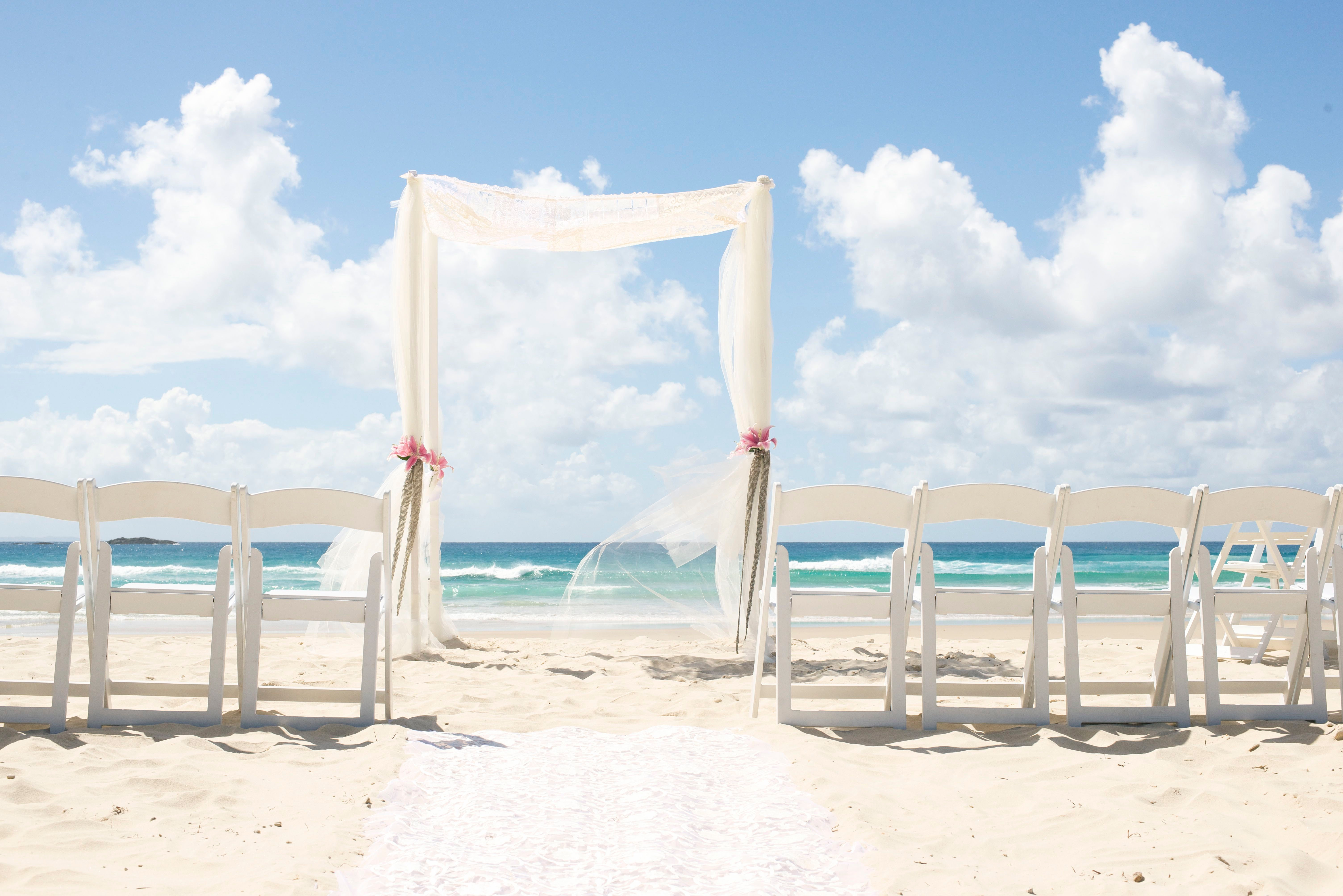 Two little rows weddings events floristry hire white wood beach wedding arbour