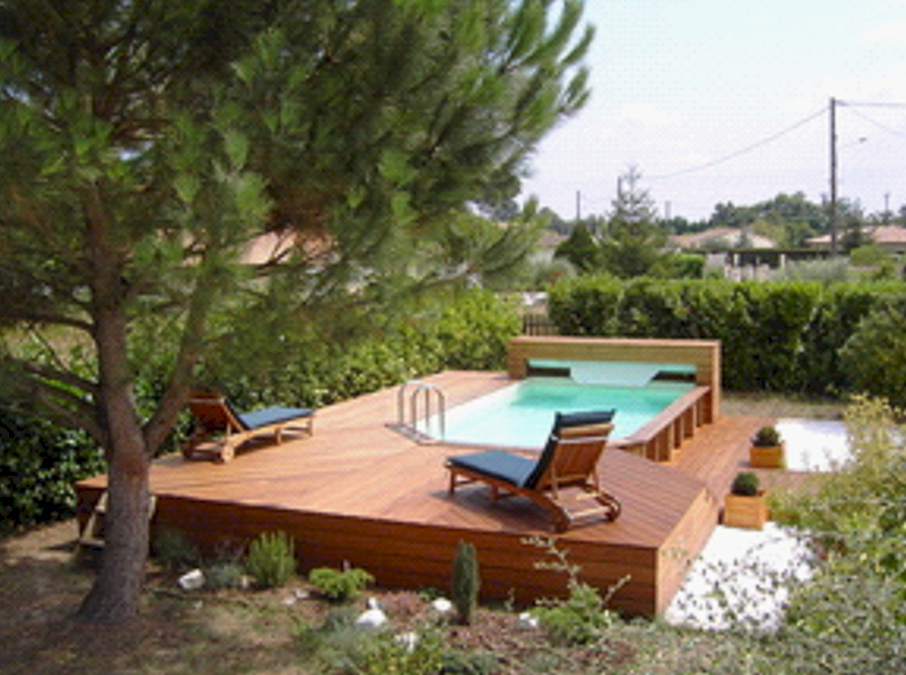 Polyesterpool schwimmbecken holzpool holz schwimmbad for Piscine hors sol bois exotique