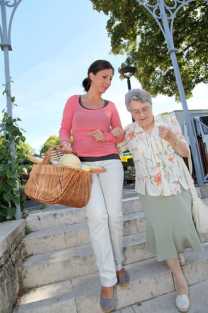 Home carer with elderly person in town.j