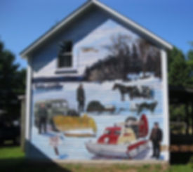 "A mural of winter transportation on Madeline Island featuring a windsled and Elmer Nelson, Evan Erickson Sr. and the Battle Ax, dogsled and river, the mail plane, ferrying across in a boat and a horse drawn ""school bus."""