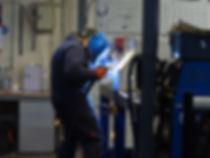 Austin welding the metal