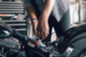 Mechanic Repairing Motorcycle