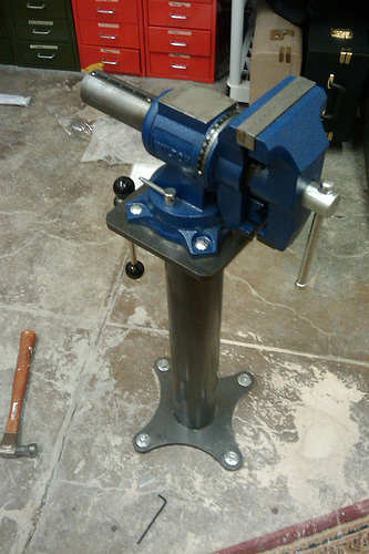 classic. Mount a large machinist vise on a heavy steel column and ...