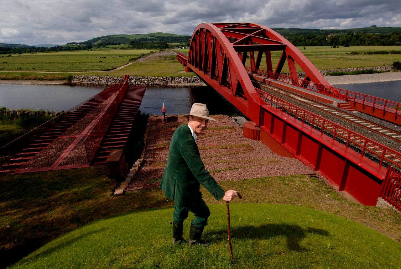 Charles Jencks pictured on a moundette overlooking the rail bridge over the River Nith