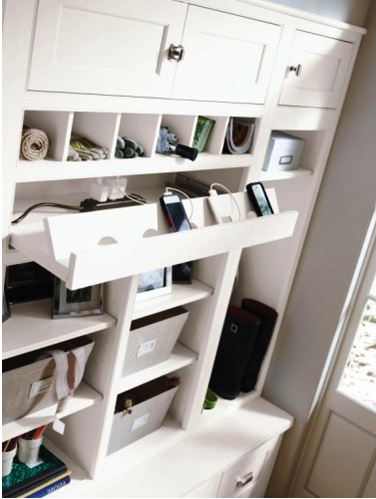 if you are considering a remodel of your kitchen bathroom and even mud room consider integrating your chargers into the cabinetry of the room such as this charging station kitchen central office
