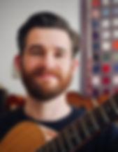 Ben smiling guitar.jpeg