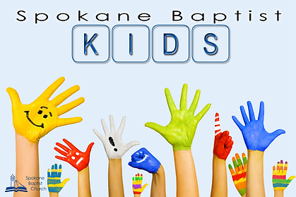 Image of painted kids hands.