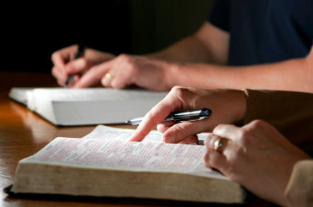 Image of people reading the Bible.