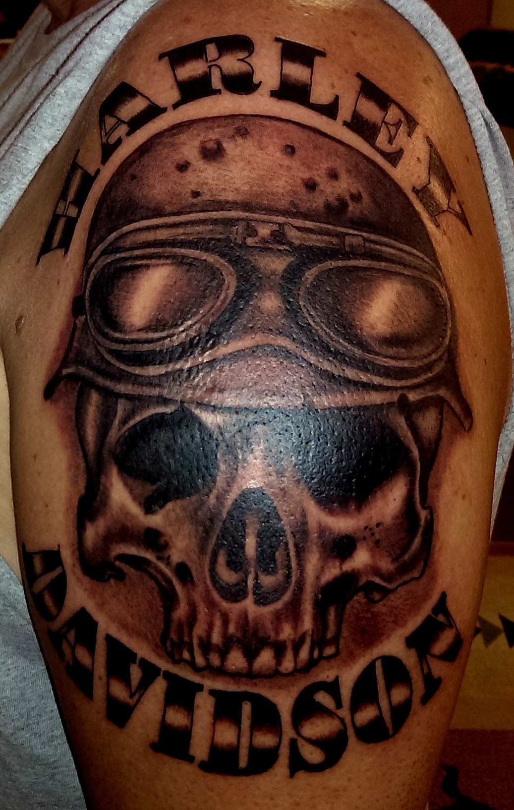 White buffalo custom tattoos body piercing dunnellon for Harley skull tattoos