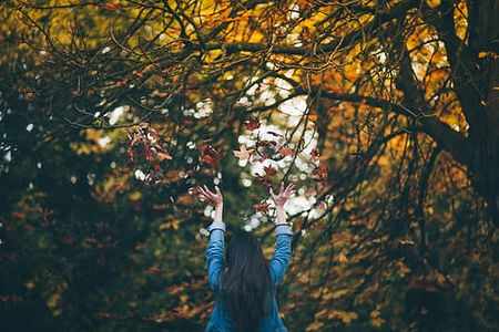woman with autumn leaves.jpg