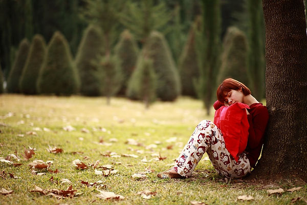 woman resting with red pillow.jpg