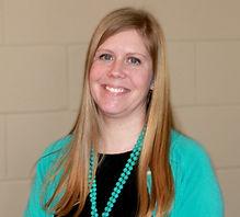 blonde female smiling leadership team director professional headshot