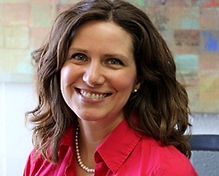 brunette woman smiling professional headshot leadership team director
