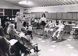 class classroom school schoolroom schoolteacher student child children wheelchair education instruction learn teach