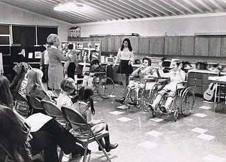 children and teachers in classroom