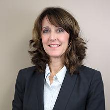 brunette female smiling professional headshot leadership board vice president