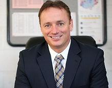 brunette male smiling leadership superintendent professional headshot