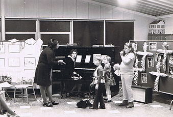 school teacher student child children adult female male piano lessons schoolroom classroom class instruction learn teach