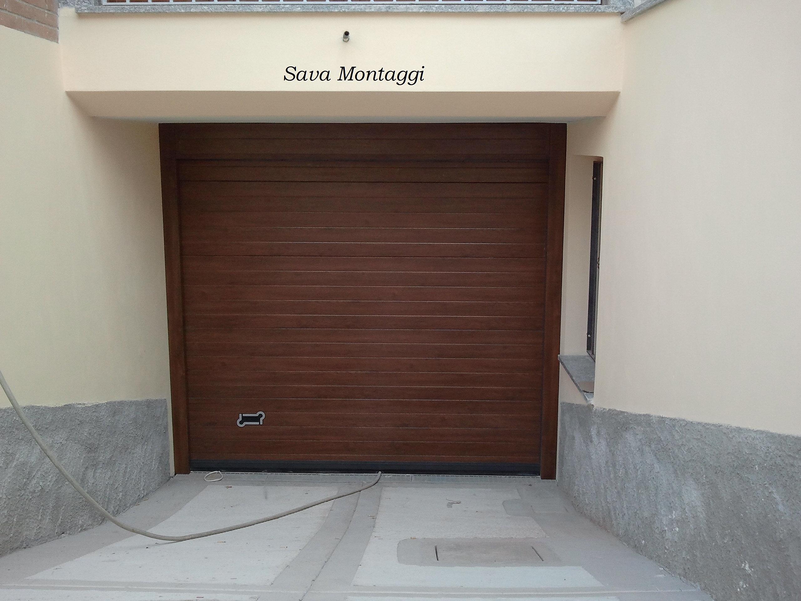 Portoni sezionali e porte basculanti per garageSezionaliMilano  piastra antieffrazione per ...