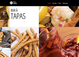 Restaurant de Tapas Template - Un modèle de site Internet contemporain et cosmopolite qui convient à tous les bars ou restaurants en vogue. Mettez-vous en appétit en personnalisant votre menu et mettez vos clients en appétit en ajoutant les images de vos plats !