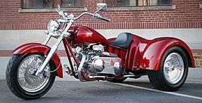 Motocicleta Con Troncos.