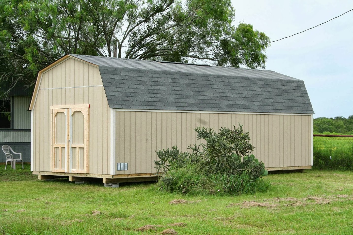 Backyard barns custom wood storage sheds san antonio for Sheds storage buildings