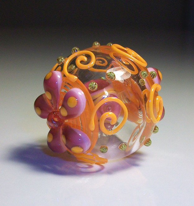 Floral and swirl bead inside a bead hollow lampwork bead