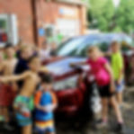 Campers washing cars