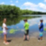 Campers fising at lake