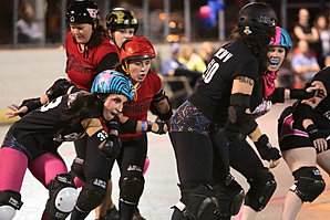 Pinky Gomez buzzes by the jammer
